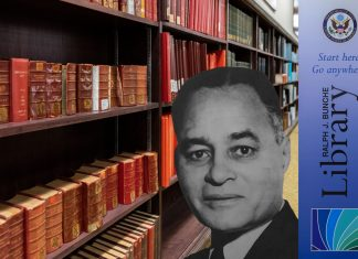 Bookshelves in the Library, with library logo and black and white photo of Ralph J. Bunche on top.
