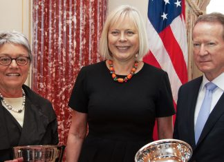 From left: Judy Ikels, Carol Z. Perez, director general of the foreign service and director of human resources and William R. Brownfield pose after being presented with the 2019 Director General Civil Service Cup and the Director General Foreign Service Cup, May 3. Photo by Heidi Howland