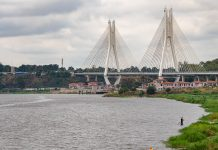 A large suspension bridge connecting Brazzaville's city center to the presidential palace is a prominent landmark along the city's popular multi-use Corniche.
