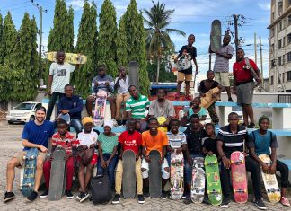 Stabilization Advisor Ian Arzeni (bottom row, left) gathers with skateboarding students following an afternoon session in Dar es Salaam, Nov. 9, 2019. Photo by Sophie Neumann