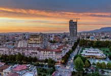 A sunset can be seen from the roof of a skyscraper in Tirana, Albania. Photo by Alexey Koimshidi