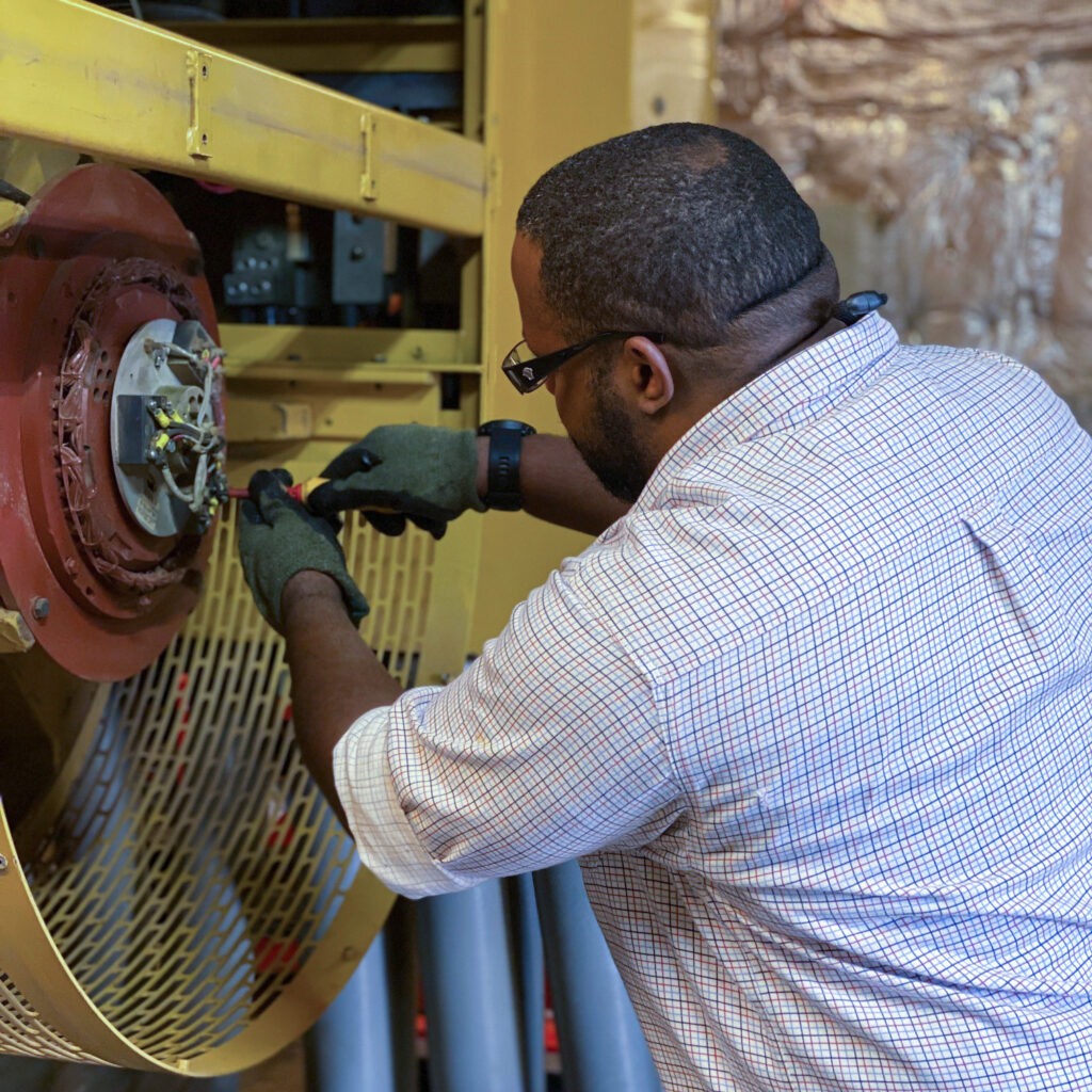 IMAP technician Elton Doxie repairs and replaces burned out diodes on one of Embassy Nairobi's generators. Photo by James Ramey