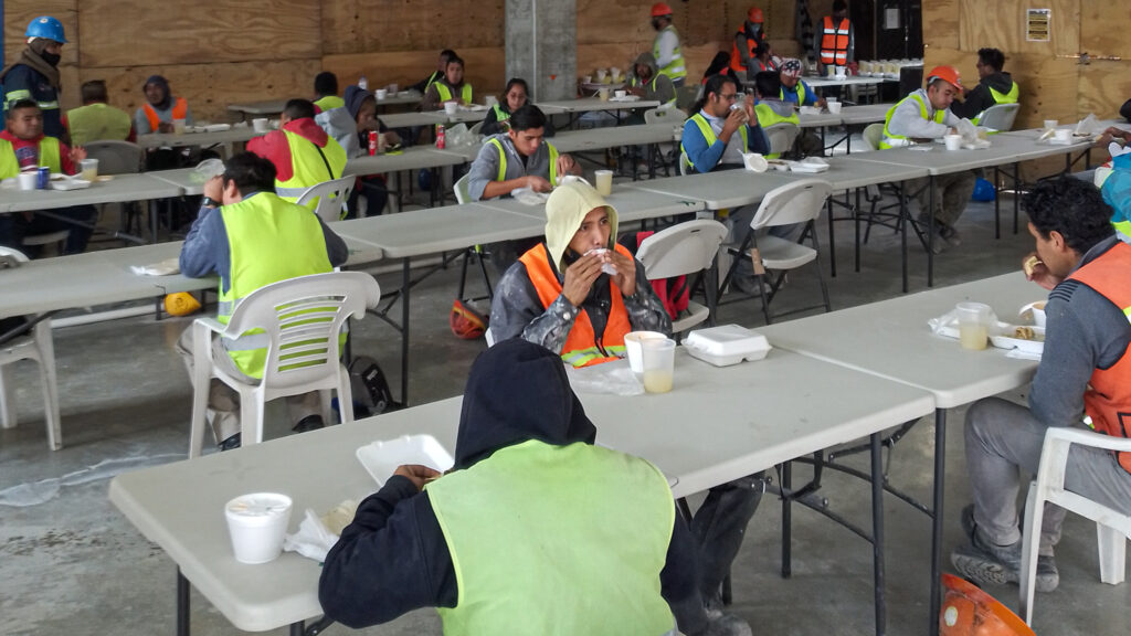 The construction site break area, where the workers take their lunch breaks, is arranged in accordance with social distancing guidelines. Photo by Jared Conrad