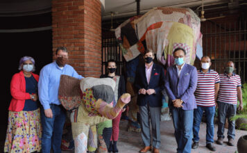 """Ambassador Earl Miller (center) and benefactor Durjoy Rahman (third from right) assembled with embassy staff to bid farewell to """"The Elephant in the Room"""" exhibition before its move to the Canadian High Commission next door, where the exhibition will continue in a location visible from the street. Photo by Arlissa Reynolds"""