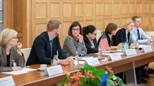S/CCI's Senior Advisor Liesyl Franz (third from left) confers with colleague David Pemberton (second from left) at the sixth annual Nordic-Baltic 8+US Cyber Consultations in Riga, one of several bilateral cyber dialogues S/CCI leads annually, October 2019. Photo by the Latvian Foreign Ministry