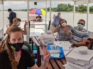 New arrivals at the embassy take a solar-powered boat tour, catered by the American Club, to get to know one another and see the beautiful Shitalakshya riverside, September 2020. Photo by Helen von Gohren