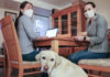 """CDI members Uyanga Erdenebold and Laura Sheehan, joined by seeing eye dog """"Dunaway,"""" work on a community podcast highlighting members of the community to showcase the diversity within Mission Japan. Photo by Mikayla Conners"""