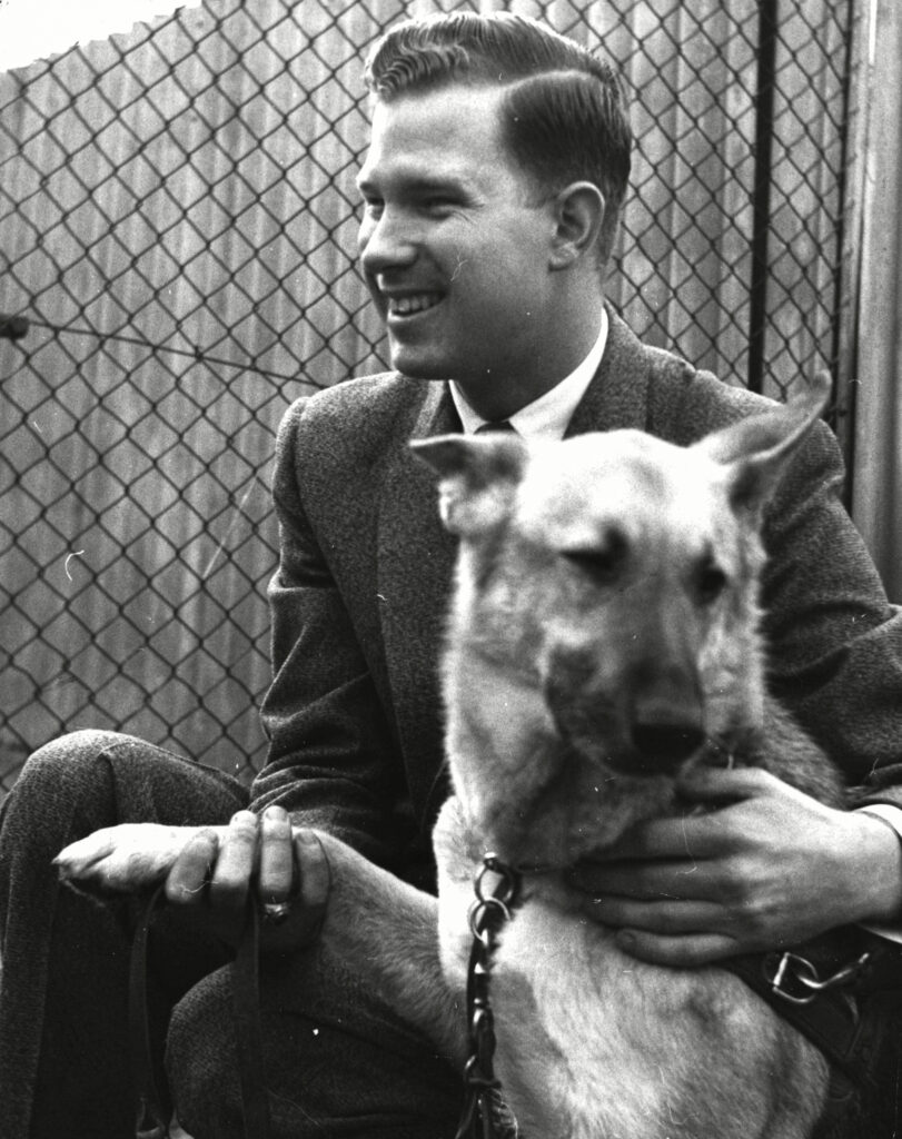 Fulbright Student Jeff Davis Duty Jr. with his guide dog Binnie, 1958. Duty, who is blind, had his exchange at the London School of Economics. He was the first known Fulbrighter with a disability. Binnie traveled with Duty to the United Kingdom and was placed in quarantine upon arrival in the United Kingdom. The photo was taken on the day they reunited. Photo by Frank Hudson